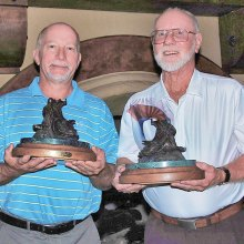 Jim Perko (left) and JR Salladay with their coveted RoadRunner Classic Saddle trophies