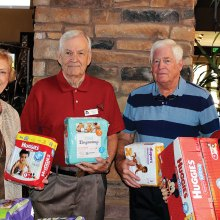 Shown with packages of diapers are Wanda Hutchison, Charles Dunn, Steve Carnahan and Sharon Sneen; photo by Clayton Thomas.