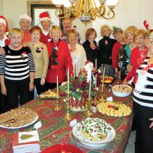 With several of their men helpers behind them, the Old Wise Ladies of Resurrection Church are ready for Cheer, Cheese and Chatter.