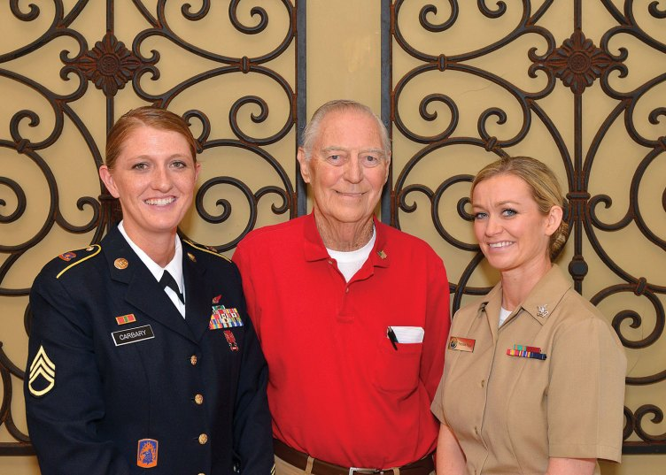 Left to right: Staff Sergeant Jamie Carbary, US Army; George Bidwell, President SaddleBrooke Troop Support and Petty Officer 2nd Class Porchea Geiger, US Navy visit Ladies Day Out.