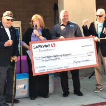 Safeway Store Manager Wendy Anderson and District Manager Jimmy Seaver present check to SaddleBrooke Troop Support President George Bidwell and Moose Creighton, announcing STS would receive an additional $5,000 grant award.