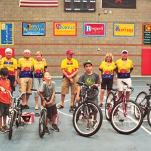 The CycleMasters enjoyed presenting bicycles to these deserving students.