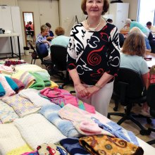 Eileen Bartsch has knitted many baby items that go to Family First.