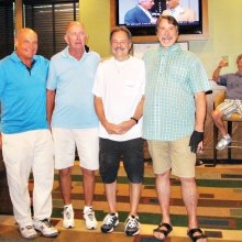 "Left to right: Bruce Fink second place, Larry Tipton fourth place, Paul ""Bankster"" Callas first place, Tom ""Half Jacket"" Barrett third place. Lurking in the background is Dominic ""The Doctor"" Borland sitting in his very familiar chair."