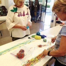 Helen and Pat lay out their scarf designs.