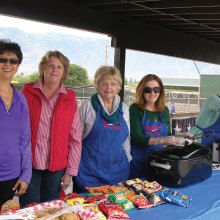 Maria from tournament sponsor Mi Pueblito along with Jane, Kandy and Ellen, are ready to serve up lunch; photo by Pat Tiefenbach