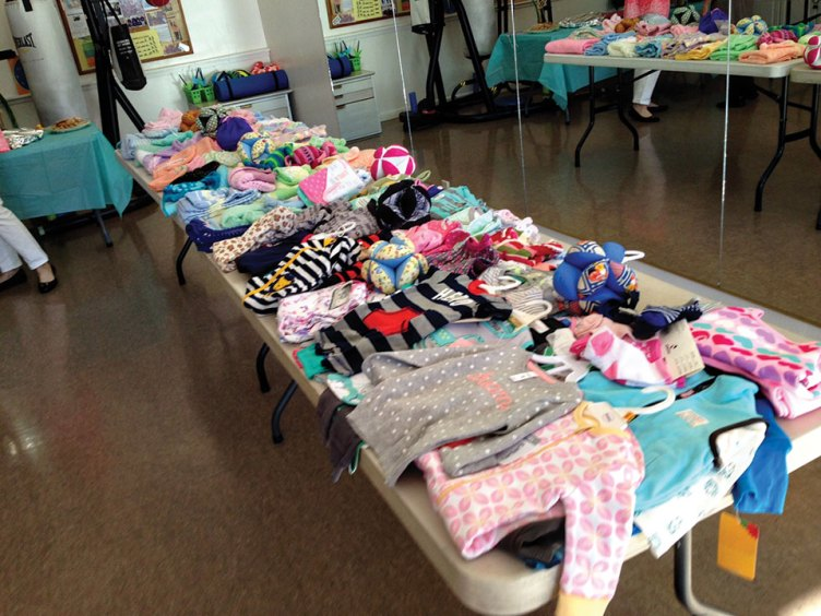 Another table loaded with knitted items and other donations
