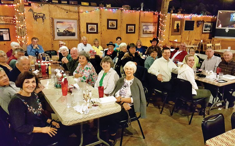 Twenty-eight Rotary members get a taste of cowboy life at Cadillac Chaparral Steakhouse and Saloon.