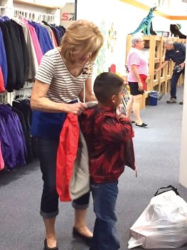 "At Kids' Closet, a volunteer ""personal shopper"" assists every child."