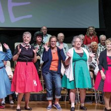 Some Singers hamming it up at their '50s Medley Melee Spring Concert; photo by Bill George