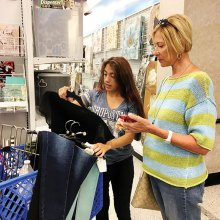 Marlene Diskin, a resident of SaddleBrooke Ranch, helps a Teen Closet shopper determine how much money she has left to spend.