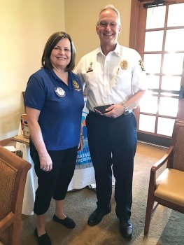 SaddleBrooke Sunrise Rotary President Debbie Foster with Fire Chief Randy Karrer