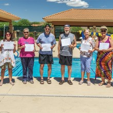 (Above) SaddleBrooke's newest swimmers from the April Adult Learn-To-Swim clinic (left to right): Linda Bowers, Karen Dewey, Barbara Burgess, Julian Imes, Joe Allen, Pat Olson, Linda Cutting, and Jean Romine. Not pictured: JeriAnn Demsky and Gale DiGiorgio.