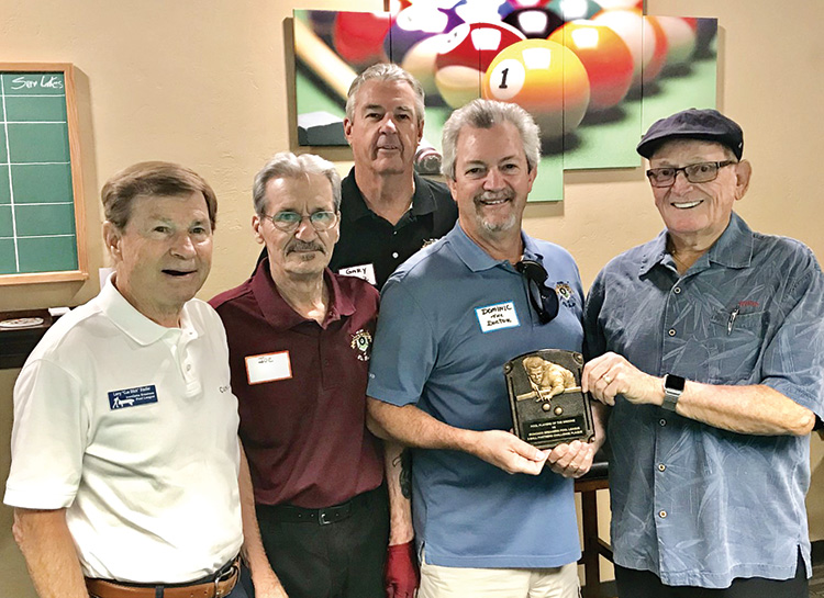 """Willie """"The Wizzard"""" Foster, Iron Oaks Breakers Pool League's Travel Team Coordinator from Sun Lakes (far right), handing over the Bronze Plaque to Dominic """"The Doctor"""" Borland PPB Travel Team Captain, while Larry """"CueStick"""" Stadler, president of The Iron Oaks Breakers Pool League (far left), and Joe """"Fast Eddie"""" Giammarino, president of the PPB (second from left), and Gary """"One Rail"""" Barlow, PPB Travel team co-captain, (center) look on."""