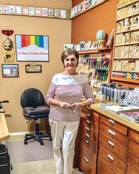 Carolyn in her craft room; photo by Keith McLean