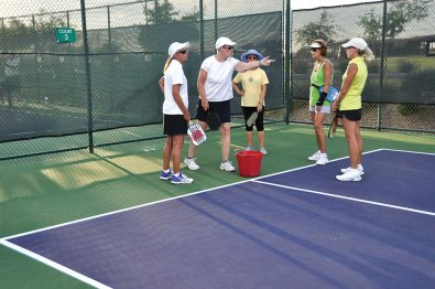 Mentor Linda Richter, second from left, prepares her group for serving practice drills. Left to right: Gretchen Malaski, Linda Richter, Consuelo Melhuish, Melanie Ritson and Michelle LeBere. undefined