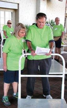 Volunteers prepare to assist exhibitors with set-up activities.