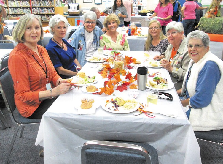 The Oracle Volunteers: Melanie Karpowitz, Penny Wilson, Linda Brush, Sharon Groth, Bonnie Richter, Claudia Hermanson and July Hans, mentor volunteers for the students.