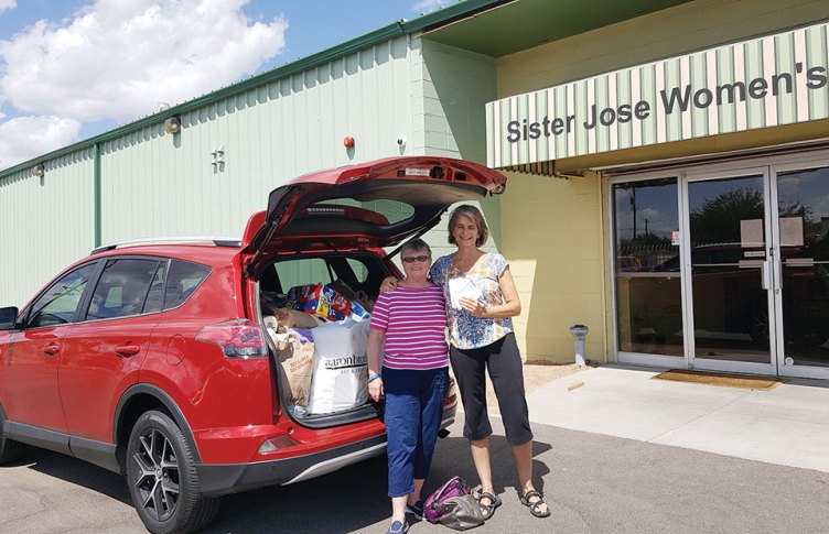 Marian Bianchini delivers the donations to Penny Buckley at SJWC, photo by Deb Lawson