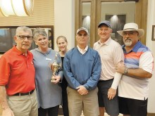 Kathy Dahlin presented the first-place men's tournament trophy to the winning team (left to right): Ernie Nedder, Kathy Dahlin, Amanda Dahlin, Bill Oprish, Stan Doepke, and Dave Blaess.