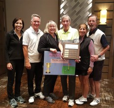 Left to right: Beth and Jon Wittmann, gross champions; Kate and Paul Thomsen, PThomsen Consulting, LLC; and Carol and Bill Mihal, net champions.