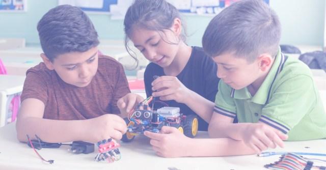 3 Children Building a Car