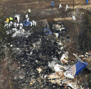 An aerial view of the site where Continental Connection Flight 3407 crashed into a home on Long Street in Clarence, N.Y., is seen Saturday morning, Feb. 14, 2009. (AP Photo/The Buffalo News, Derek Gee) ** TV OUT, MAGS OUT,  FOREIGN OUT, MANDATORY CREDIT **