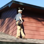 Home inspector on roof