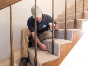 Home Inspector Measuring Stairs