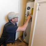 Home inspector checks water heater