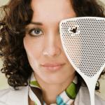 Woman holding flyswatter