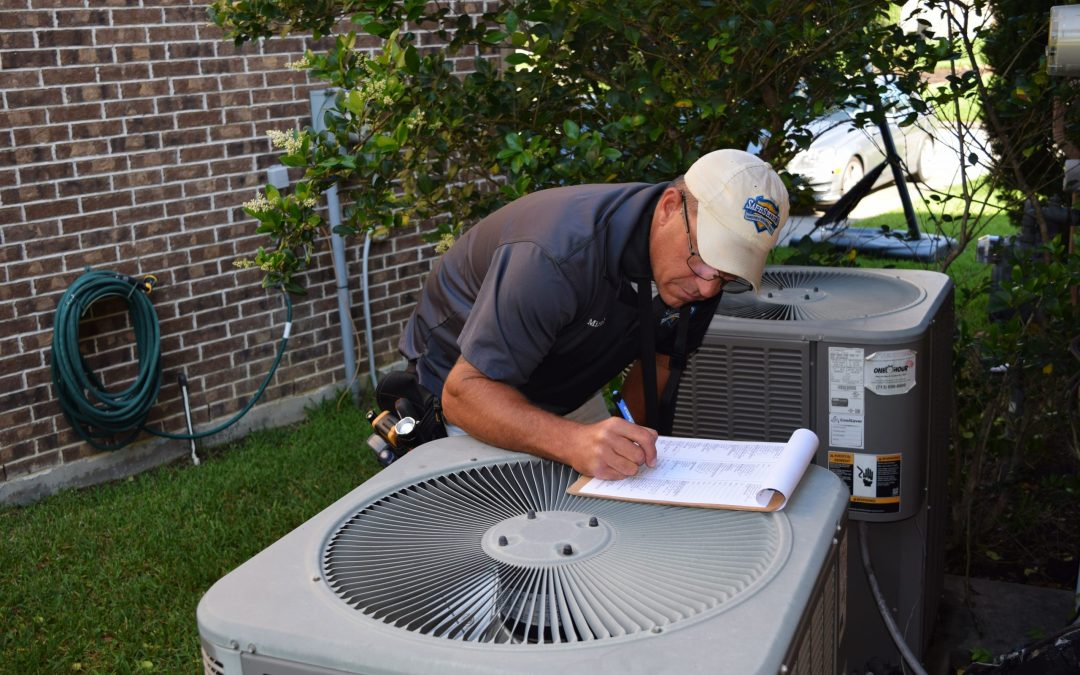 Inspector examines air conditioners