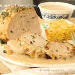 Herb crusted turkey breast with sage butter and roasted garlic gravy