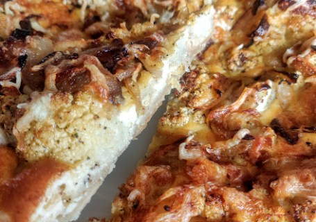 Cauliflower quiche with caramelised onions.