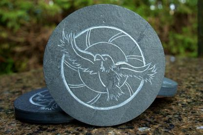 Flying eagle with sun in background, coaster stone carving