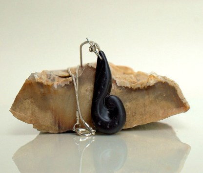 Hand carved black stone pendant with silver setting