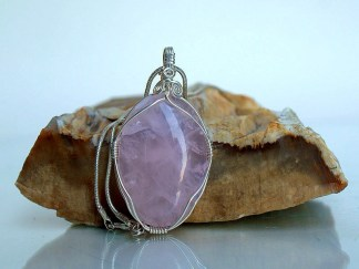 Translucent pink silver wire wrapped gemstone pendant