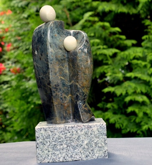 couple embracing soapstone sculpture