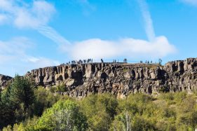travel to Iceland - people at Observation Deck of Almannagja fault in Thingvellir national park in autumn