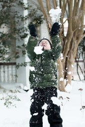 The joy of throwing snow.
