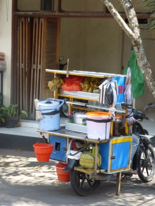 """""""Meals on Wheels"""" Everything on the back of a moped."""