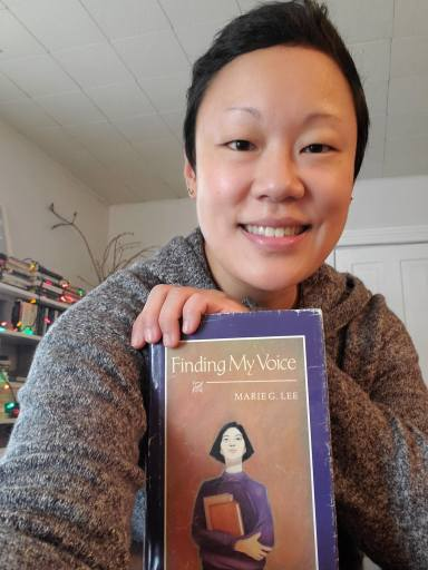 """Emily Swanson, 39, of Minneapolis holds her copy of """"Finding My Voice."""""""