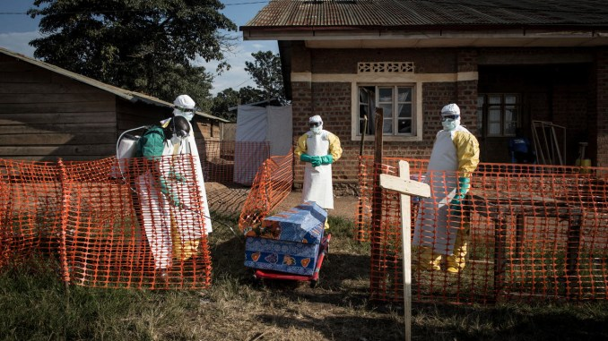 DR Congo medical workers disinfect the coffin an Ebola victim in 2018