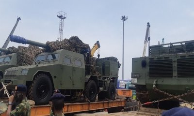 "Nigerian military receives tanks, artillery from China. Nigeria's military has taken delivery of VT-4 main battle tanks, SH-5 self-propelled howitzers and other equipment from China in an effort to strengthen its land forces in the battle against Boko Haram militants. The equipment was acquired from China's Norinco after being ordered last year under an apparent $152 million contract. The equipment was unloaded on 8 April and included VT-4 main battle tanks, SH5 105 mm self-propelled artillery and other items. Nigerian Army Chief of Policy and Plans Lieutenant General Lamidi Adeosun said, ""The process of acquiring this has been on for some time but thank God they are coming in now. From this, you can see how serious the Federal Government of Nigeria is in making sure that the Nigerian Army is not only equipped, but contains problem of insecurity we are having across the country. ""This is being tackled with trained personnel and required equipment. What you are seeing here is just a tip of the iceberg. Others are still coming but it is very important that we all see that both the military and the government are really very serious to tackle the security problems across the nation."" Adeosun said the delivery from China includes main battle tanks, light tanks and two types of artillery. He added that personnel have been trained in China to operate the equipment. According to Nigerian media, 17 vehicles were offloaded on Wednesday, including VT-4 main battle tank and ST1 light tanks. Photos confirm VT-4 and SH-5 vehicles were delivered. In May 2019, Minister of Defence, Brigadier General Mansur Dan-Ali, said the Nigerian government had provided funding for the acquisition of modern equipment for the Nigerian armed forces, with some in service and others on the way. This included 35 main battle tanks, 25 Typhoon MRAPs (mine-resistant, ambush protected vehicles), 10 Spartan armoured personnel carriers, 20 Armoured Guard Booths, five armoured mine-clearing vehicles, 50 troop-carrying vehicles and 40 Buffalo vehicles, among others for the Nigerian Army. In addition, four Ships, 182 rigid hull inflatable and Epenal boats, four inshore patrol craft, two STAN Patrol Vessels and one helicopter were procured for the Nigerian Navy. The Nigerian Air Force has benefited from the acquisition of 25 fixed wing aircraft and 12 helicopters, Dan-Ali said at the time. The VT-4 (MBT-3000) main battle tank was built by Norinco for the export market and unveiled internationally in 2012. The 52-ton vehicle has a crew of three (commander, driver and gunner – an automatic loader reduces crew numbers). It is armed with a 125 mm smoothbore cannon, a remotely operated 12.7 mm anti-aircraft machine gun and a 7.62 mm coaxial machine gun but can also fire guided missiles. It can be fitted with a GL5 active protection system. The vehicle's fire control unit also comprises roof-mounted panoramic sights, a laser warning device, and a digital gun control system designed to support day and night operation. A 1 200 hp turbocharged diesel engine gives a maximum speed of 70km/h and range of 500 km. The SH5 self-propelled artillery system is a development of Norinco's SH2. It is armed with a 105 mm gun on a 6×6 platform. The gun has an elevation of zero to 70 degrees with traverse being 30 degrees left and right. Range of the weapon is around 18 km. The SH5 is fitted with a computerized fire-control system, including GPS navigation and positioning, targeting, and communications systems. The SH5 has an armoured crew compartment, which is protected again small arms fire and shell splinters. The vehicle has a top speed of 100 km/h and range of 800 km."