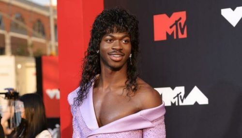 Lil Nas X's Sparkly Purple Suit Dress Dismissed and Disliked By MTV VMA Interviewer