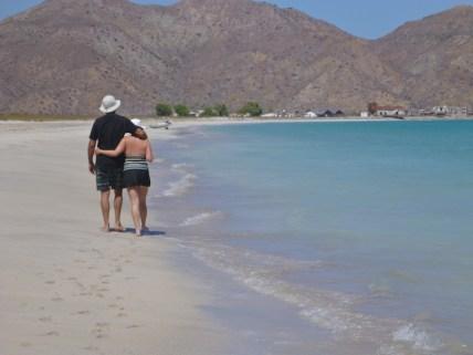 Lovebirds walking the beach at Bahia Salinas