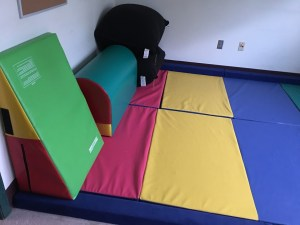 Set floor pads in a child's play room