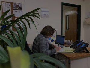 Woman completing paperwork at her desk