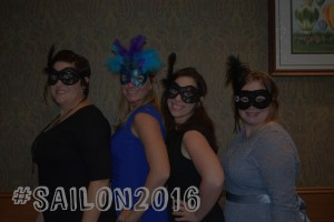 SAIL employees wearing carnival masks at a fundraising event