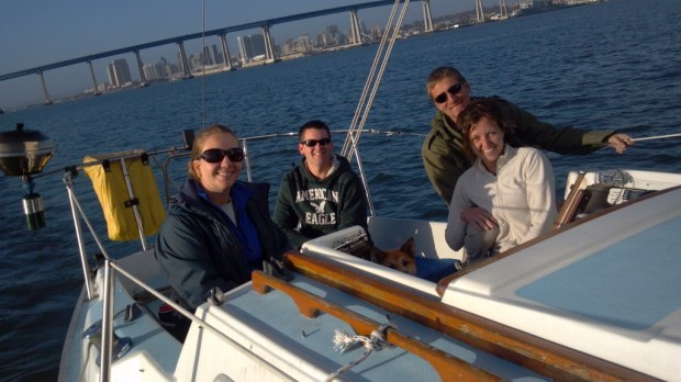 natalie, clay, eric and jaime sailing airborne with the coronado bay bridge in the background